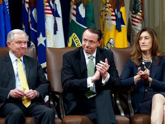 Attorney General Jeff Sessions accompanied by Deputy Attorney General Rod Rosenstein and Associate Attorney General Rachel Brand, during the opening ceremony of the summit on Efforts to Combat Human Trafficking at Department of Justice in Washington, Friday, Feb. 2, 2018. President Donald Trump, dogged by an unrelenting investigation into his campaign's ties to Russia, lashes out at the FBI and Justice Department as politically biased ahead of the expected release of a classified Republican memo criticizing FBI surveillance tactics.   (AP Photo/Jose Luis Magana)