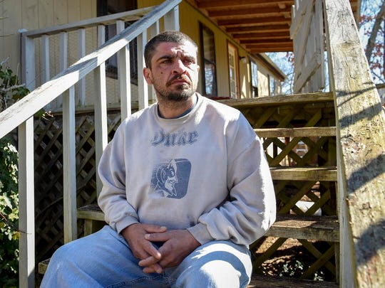 Brian Hogan, whose daughter was taken away from them by Cherokee County Dept. of Social Services at his home on Wednesday, March 14, 2018, in Murphy, N.C. (AP Photo/Kathy Kmonicek)