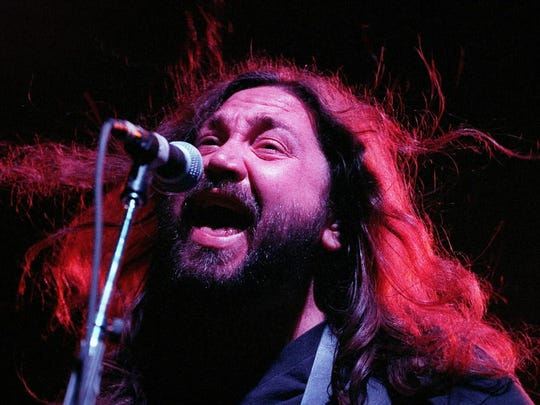 David Schools of Widespread Panic bellows at the microphone Thursday July 2, 1998 at the Marcus Amphitheater during Summerfest.