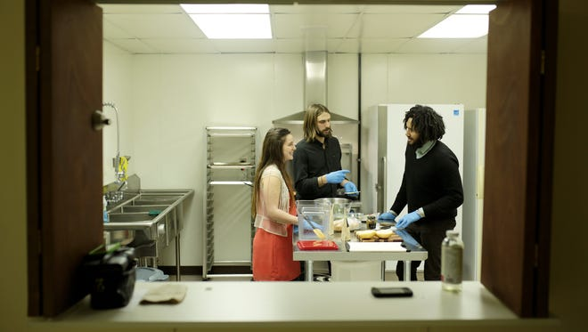 (From left) Farrin Forsberg, 25, of Lansing, managing partner, co-founder Theodore Kozerski, 26, of Detroit and co-founder Anthony Hatinger, 26, of Detroit work in their kitchen on Friday, Feb. 26, 2016, at the New Center in Detroit.