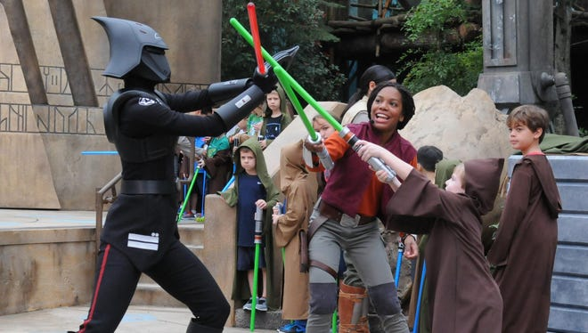 A Jedi apprentice and her Padawan learner battle Seventh Sister at the Jedi Training Academy at Disney's Hollywood Studios.