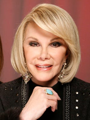 "FILE - In this Jan. 18, 2011 file photo, TV personality Joan Rivers poses for a portrait in New York.  Rivers, along with Regis Philbin, Rhea Perlman and Kevin Nealon will be guest-starring on the TV Land series, ""Hot in Cleveland."""