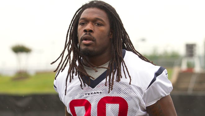 Houston Texans outside linebacker Jadeveon Clowney walks to practice during an NFL football minicamp, Tuesday, May 27, 2014, in Houston.