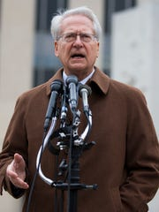 Larry Klayman speaks to reporters outside the E. Barrett Prettyman Federal Courthouse on Dec. 22, 2014.