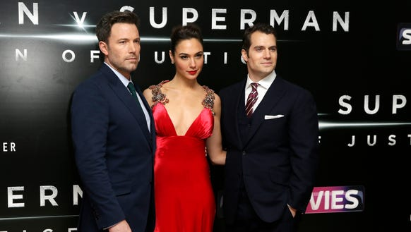 Affleck, from left, Gal Gadot and Cavill pose for photographers