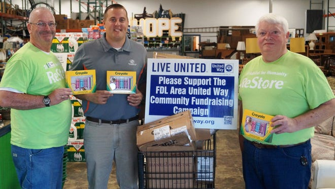 Pictured from left are Paul Osterholm, executive director of Habitat for Humanity of Fond du Lac County; Dan Hebel, chief executive officer, Boys & Girls Club of Fond du Lac; Keith Lee, ReStore manager, Habitat for Humanity of Fond du Lac County