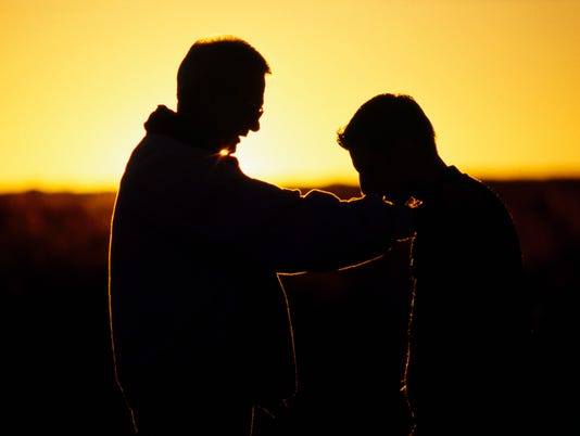 Silhouette of a father and son