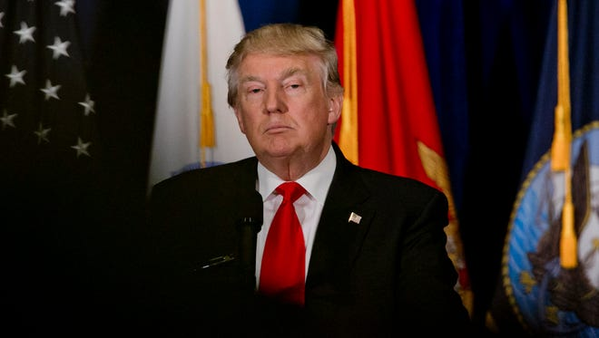 Donald Trump gazes at the audience following a standing ovation during his speech at Westin Town Center in Virginia Beach, Va., on July 11, 2016.