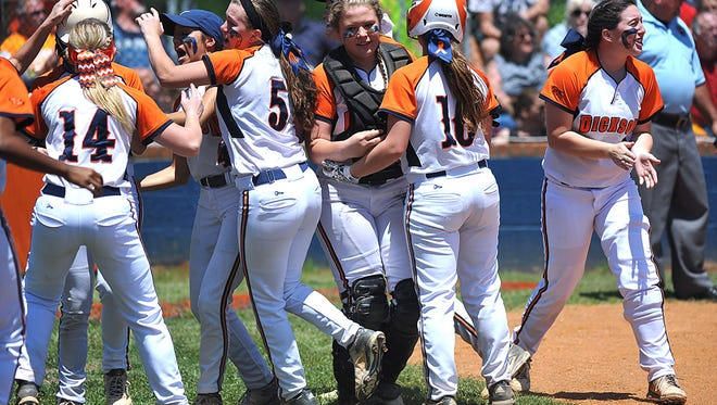 Dickson County players celebrate Sunday's Class AAA Sectional win over Hendersonville.