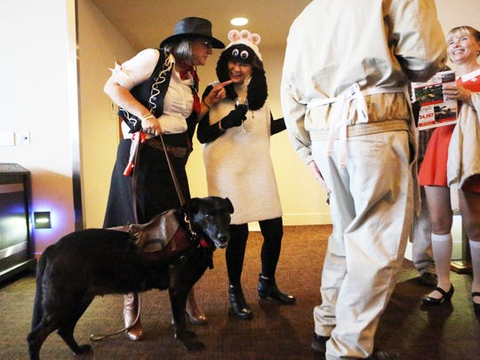 Animal lovers dress up for Bowser's Boo Bash, a silent auction benefiting the Willamette Humane Society at the Salem Convention Center.