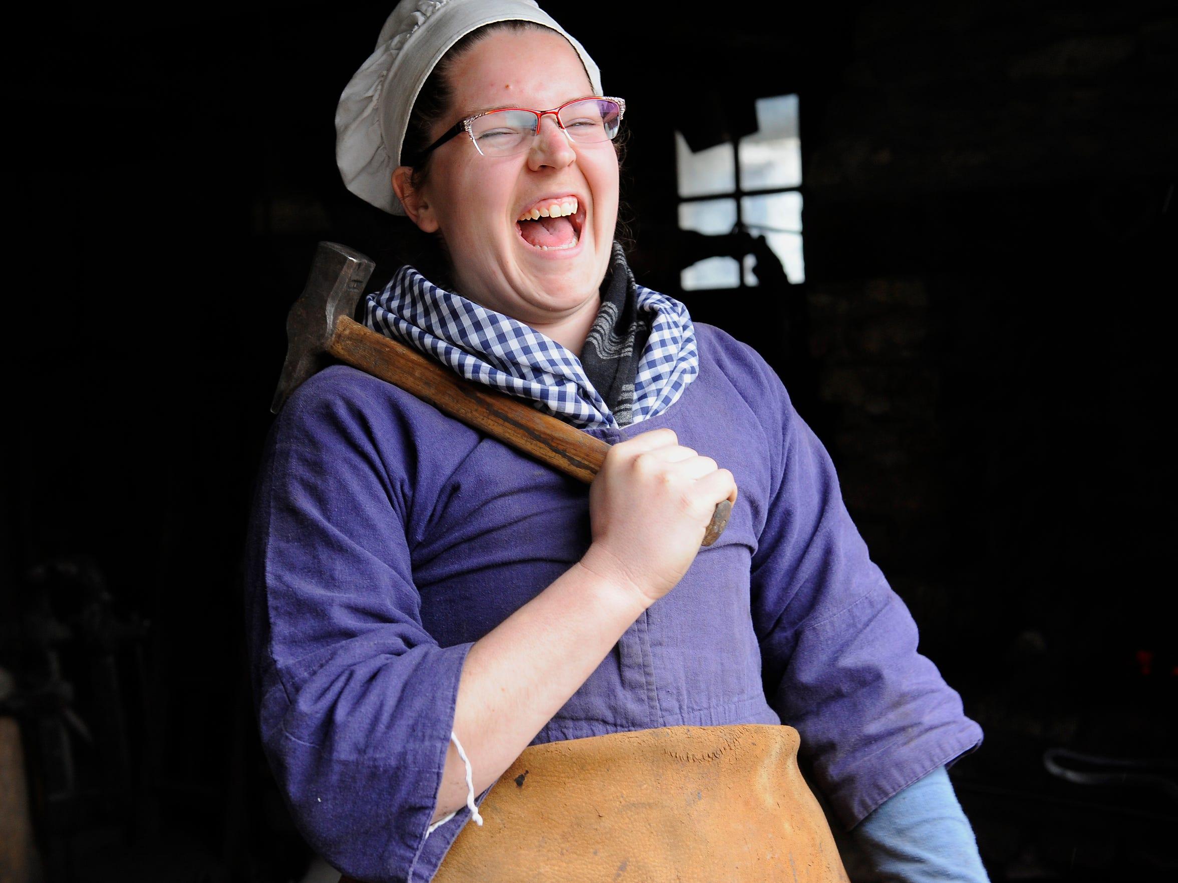 Blacksmith Dena Bliss laughs as she talks to visitors