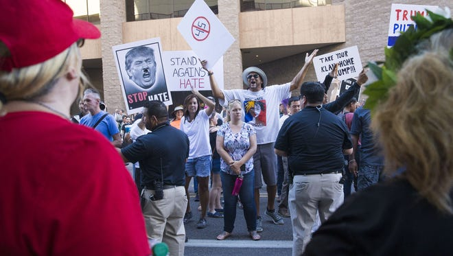 Protesters argue with Trump supporters outside the Phoenix Convention Center on Aug. 22, 2017. President Donald Trump will hold a rally in Phoenix on Tuesday night.