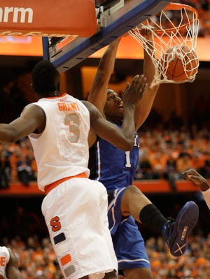 Dukeís Jabari Parker, right, jams over Syracuseís Jerami Grant, left, in the first half of an NCAA college basketball game in Syracuse, N.Y.