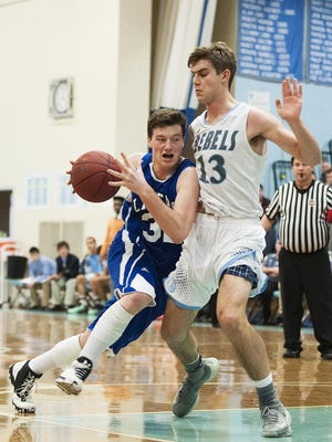 Colchester's Stephen Emmons (32) drives to the hoop past South Burlington's Harrison Gregoire (13) during the boys basketball game between the Colchester Lakers and the South Burlington Rebels at South Burlington High School on Saturday afternoon.