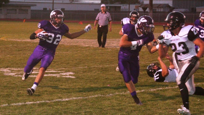 Yerington senior Reese Neville follows the block of junior Michael Monahan during this first quarter run in last month's 23-16 win over Spring Creek.