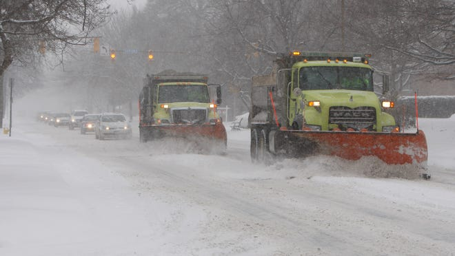 City snowplows were out in force clearing East Avenue as heavy snow blanketed Rochester on Wednesday.