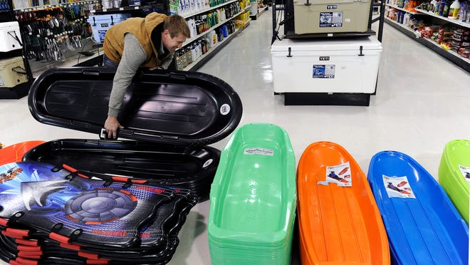 Jason Burrage of Spring Hill picks out a sled for his two children at Harpeth True Value hardware store in Franklin. The store was busy selling sleds, salt and propane on Sunday.
