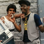 """This image released by CNN Films shows a scene from """"Fresh Dressed,"""" a new documentary that explores the roots of hip-hop fashion, from southern plantation culture and the rise of Little Richard to the gang warfare of the burned-out, 1970s South Bronx and knockoff king Dapper Dan in Harlem. (CNN Films via AP)"""