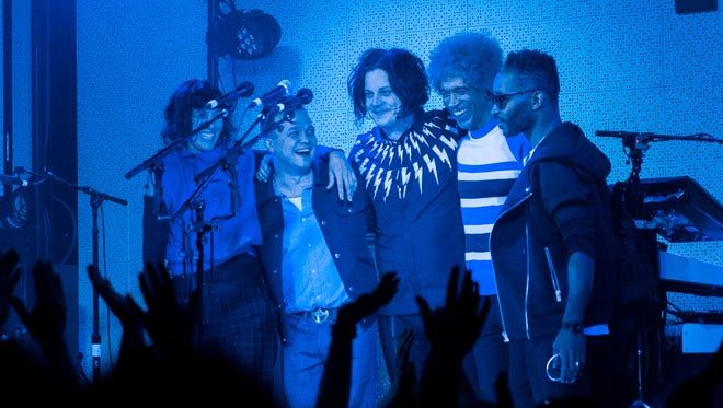 Jack White, center, takes a bow with his bandmates Carla Azar, Dominic Davis, Neal Evans and Quincy McCrary at Third Man Records in Nashville, Tenn. March 15, 2018.
