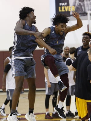 Romello White (left) and Remy Martin (right) celebrate a buzzer beating shot. Members of Arizona State's men's basketball team practiced early Tuesday afternoon in preparation for a team trip through Europe where they will play three games against professional opponents.