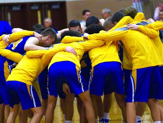 The Waynesboro boys basketball team huddles before