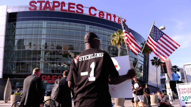 Dewayne Williams of Memphis participates in a demonstration in front of Staples Center demanding.
