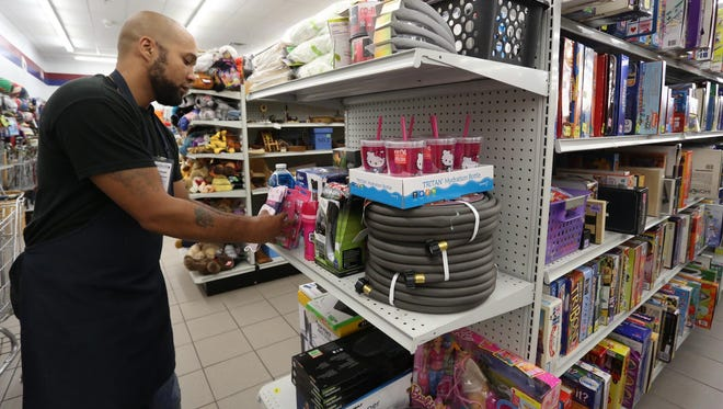 Mike Ike stocks shelves as he volunteers at Goodwill in Marshfield on Thursday. He is a graduate of drug court in Wood County.