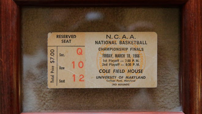 A framed ticket stub from the 1966 NCAA Championship game that featured Texas Western College and the University of Kentucky, which sold for $7. Texas Western went on to defeat the Wildcats with five black players as their starting lineup against five white players.