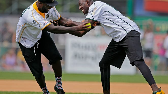 Is there holding in baseball? Donald Driver, right, and Nick Collins battle at second base as the Donald Driver Celebrity Farewell softball game takes place Sunday, August 13, 2017, at Neuroscience Group Field at Fox Cities Stadium in Grand Chute, Wis.Ron Page/USA TODAY NETWORK- Wisconsin