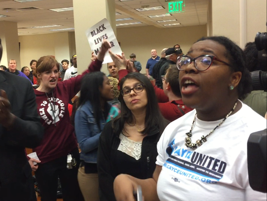 Protesters demand action at Tuesday's Metro Council