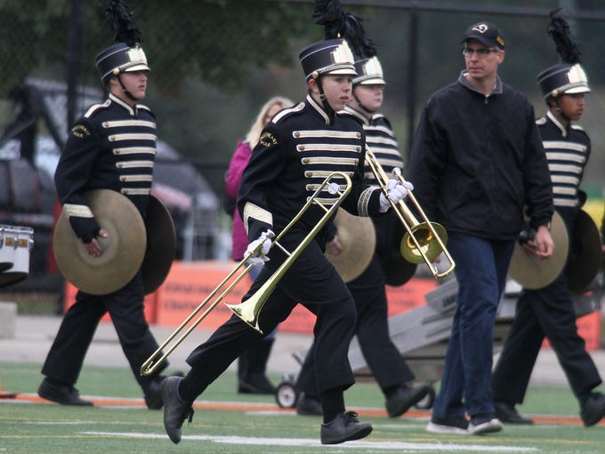 The Southeast Polk High School Marching Rams take the