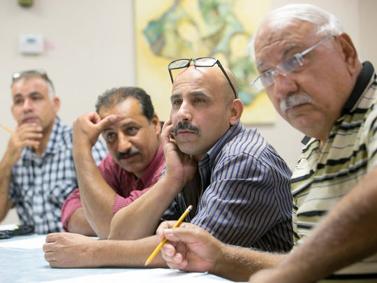 Usabah Algaraawi (left) Ayad Hassan, Ari Ahmed and Philips Somo take an English as a Second Language class at The Iraqi American Society for Peace and Friendship in Phoenix.