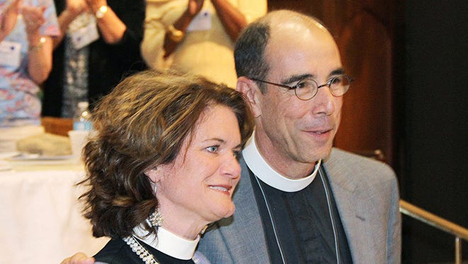 This 2014 photo shows The Rt. Rev. Brian Seage (right) standing with his wife, the Rev. Kyle Seage.