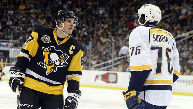 Pittsburgh Penguins center Sidney Crosby (87) talks with Nashville Predators defenseman P.K. Subban (76) during a timeout in the second period of a January game at PPG Paints Arena.