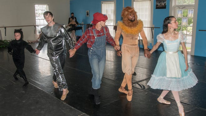 """The Scarecrow (Danny Mitsios), Dorothy (Rania Charalambidou), Tin Man (Carl Bachman), the Cowardly Lion (Ryan Arnold), and Dorothy's little dog Toto (Margie Anne Prescott). Rehearsal for """"The Wizard of Oz"""" on Saturday, May 5, 2018. The Montgomery Ballet presents """"The Wizard of Oz"""" and """"Napoli"""" on May 12-13 at the Alabama Shakespeare Festival."""