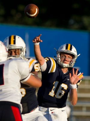 Castle's Dayne Keller (16) throws against Terre Haute North during their game at John Lidy Field at Castle High School Friday night.