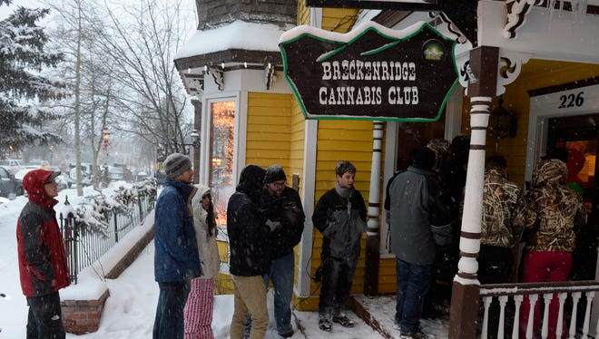 A line waits outside the Cannabis Club on Main Street in downtown Breckenridge, Colo., for an 8 a.m. opening of the store on Jan. 1.