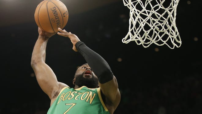 Boston Celtics guard Jaylen Brown (7) prepares to dunk the ball during the first half against the Brooklyn Nets at TD Garden on March 3, 2020.