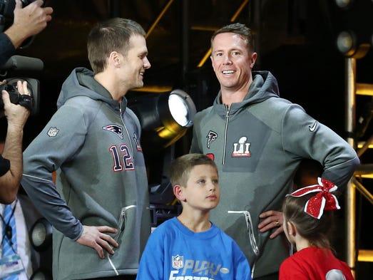 New England Patriots quarterback Tom Brady (left) talks