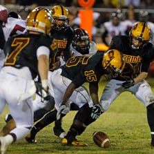 Mountain Pointe's Keondre Churchwell scoops up a fumble against Mesa Desert Ridge in their Division I semifinal game last November.