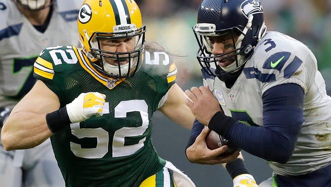Packers linebacker Clay Matthews chases Seahawks quarterback Russell Wilson during their game last season at Lambeau Field.