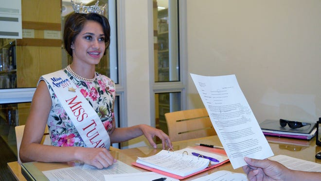 Elizabeth Sartuche prepares for the Miss California pageant with mock interview questions Tuesday afternoon, at the Tulare Public Library. She leaves for the week long competition on Thursday.