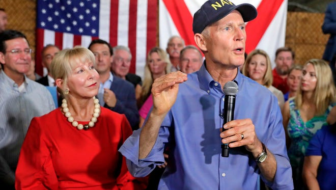 Florida Gov. Rick Scott, with his wife, Ann, left, beside him, announces his bid to run for the U.S. Senate at a news conference April 9 in Orlando.