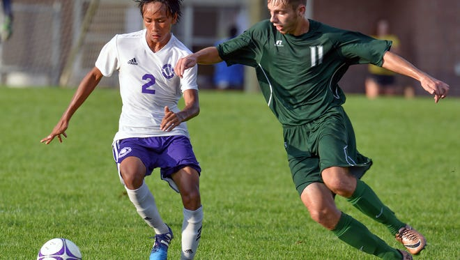 Lakeview's Elija Mang battles for the ball with Pennfield's Isaac Ayres.