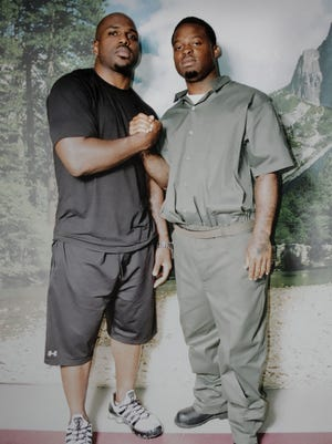 Tampa Bay Buccaneers running back Earnest Graham, left, with his brother, Brandon, at prison February 2008. Brandon Graham is serving a prison sentence for distribution of crack cocaine.
