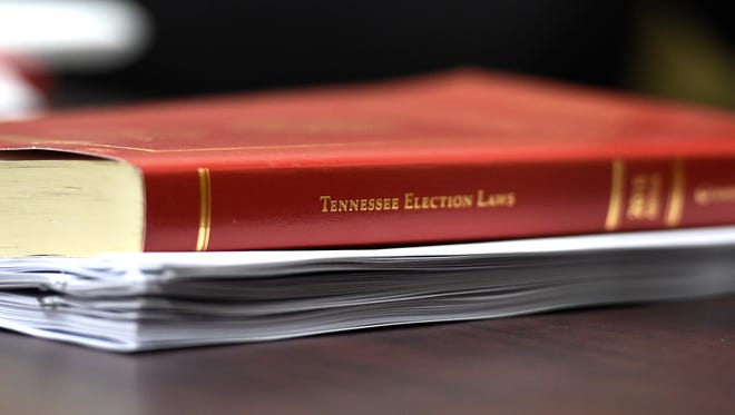 A Tennessee Election Laws book rests on a table at the Bureau of Ethics and Campaign Finance Registry of Election Finance   in Nashville, Tenn., Wednesday, Feb. 8, 2017.