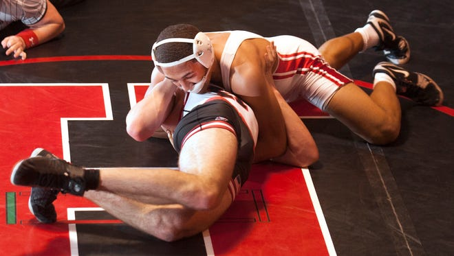 Paulsboro's Brandon Green pins Haddonfield's Mike Carey during the 170 lb. bout of Friday's wrestling match held at Haddonfield High School.  01.19.18