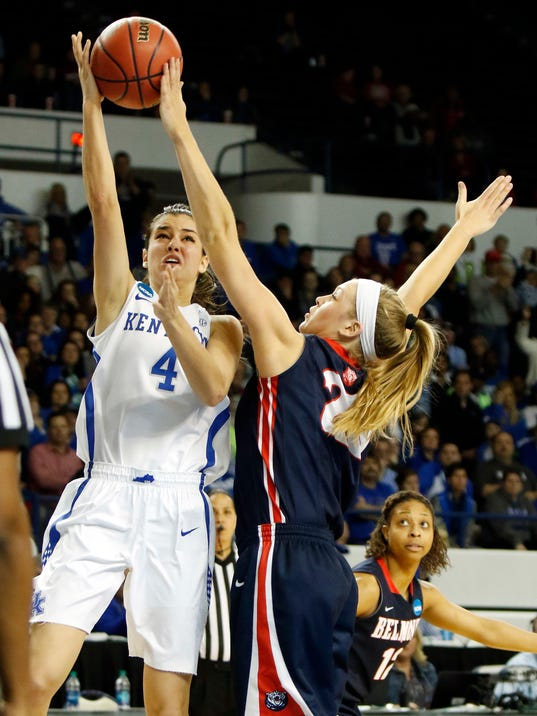 Kentucky's Maci Morris, left, has her shot pressured by Belmont's Kylee Smith, right, during a first-round game in the women's NCAA college basketball tournament in Lexington, Ky., Friday, March 17, 2017. Kentucky won 73-70. (AP Photo/James Crisp)