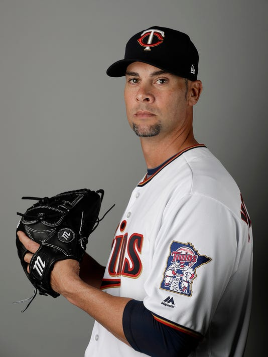 "FILE- In this Feb. 23, 2017, file photo, Minnesota Twins' Ryan Vogelsong poses for a picture during the team's media day at spring training baseball in Fort Myers, Fla. The right-hander started for the Twins on Sunday, March 12, against the Pittsburgh Pirates in Bradenton, Fla. ""I still think I can get big league guys out consistently and help a team win, so that's why I'm here,"" Vogelsong said. (AP Photo/David Goldman, File)"