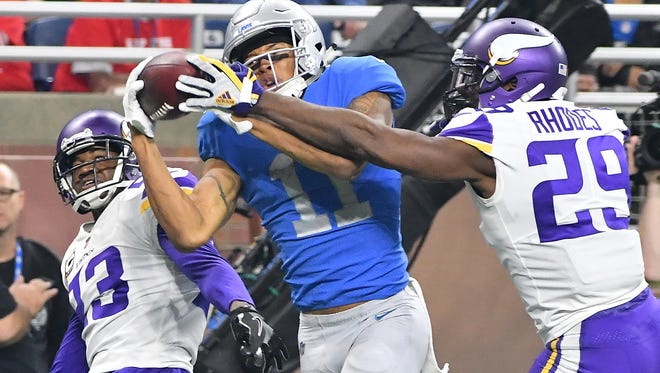 Lions wide receiver Marvin Jones Jr. pulls in an amazing reception along the sidelines and into the end zone for a touchdown between Vikings defenders of Terence Newman and Xavier Rhodes in the fourth quarter.
